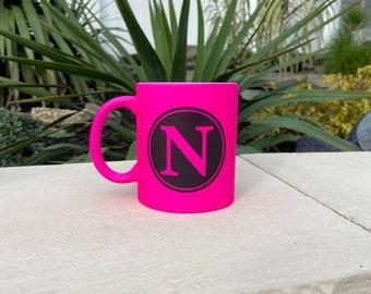 Monogram 11 ounce ceramic coffee mug.