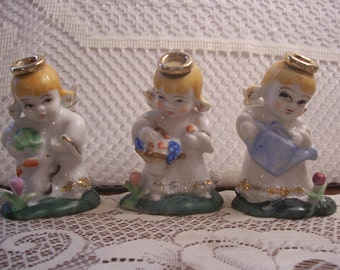 Three Gardening Angel Figurines with Sugar Trim