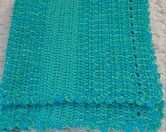 Turquoise blue dog/cat blanket, measures 28 inches by 32 inches