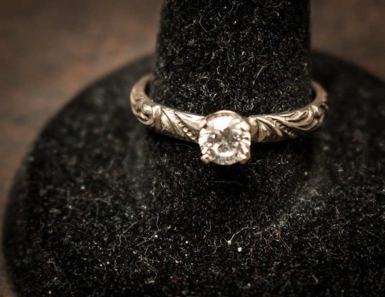 faceted round cut cz ring