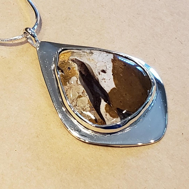 Rock Calcite natural stone set in modern Sterling Silver Pendant with chain.