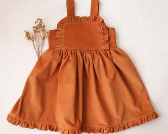 Ochre Corduroy Ruffle Bib Pinafore Dress