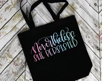 Nevertheless, she persisted. Calligraphy Tote. Black Tote Bag. Feminist. Woman. Calligraphy Font. Feminist Tote Bag. Charity. Donation.