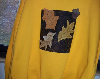 Gold sweatshirt with fall colored leaves. XL