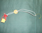 Teapot dripcatcher with Chinese coin charm