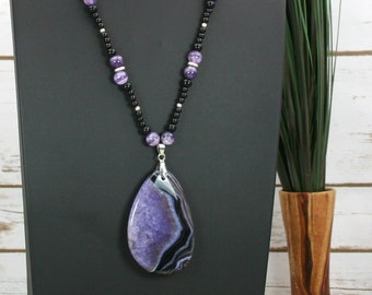 Purple and black dragon veins agate teardrop pendant on beaded strand of amethyst, obsidian, and silver