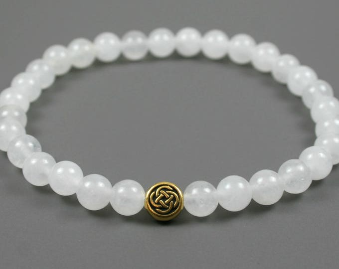 Snow quartz stacking stretch bracelet with antique gold plated Celtic knot bead