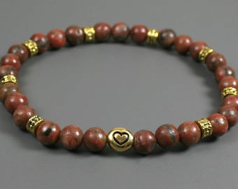 Red sesame jasper stacking stretch bracelet with antique gold plated heart accent bead and antiqued gold rondelles