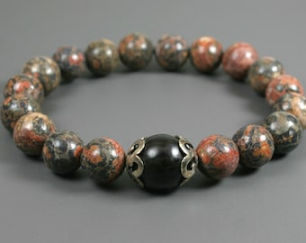 Leopardskin jasper stacking stretch bracelet with buri root accent flanked by antiqued sterling silver bead caps