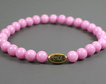 Pink dolomite stretch bracelet with antiqued gold plated pewter LOVE bead