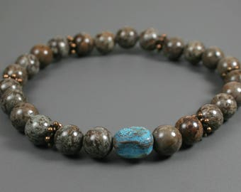 Brown snowflake jasper stacking stretch bracelet with a turquoise dyed quartzite focal and antiqued copper roundels, brown stone bracelet