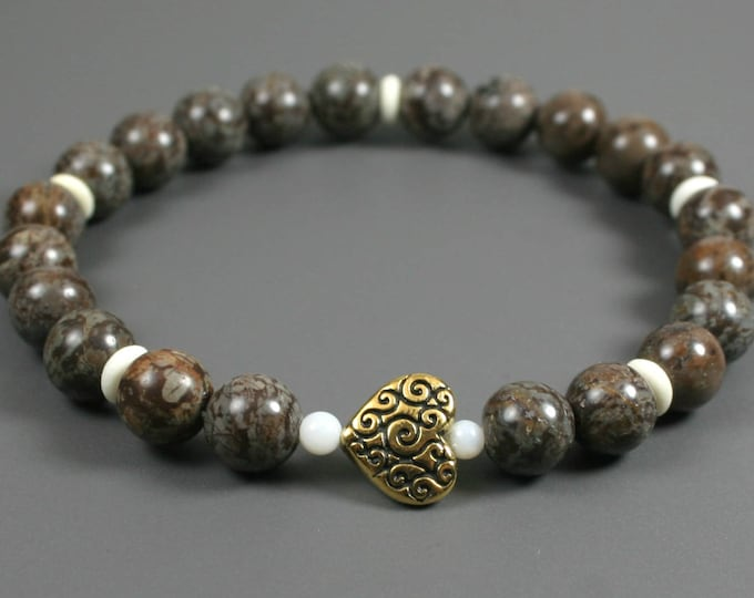 Brown snowflake jasper stacking stretch bracelet with an antiqued gold plated heart scroll focal bead, white shell beads, and bone spacers