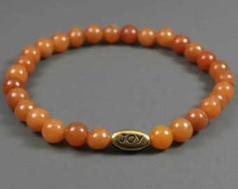 Red aventurine stacking stretch bracelet with antiqued gold plated pewter JOY bead