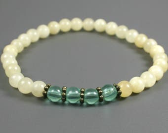 Yellow calcite and turquoise glass stacking stretch bracelet with antiqued brass accents