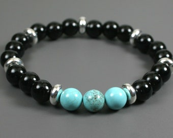 Turquoise magnesite and obsidian stacking stretch bracelet with silver plated spacers