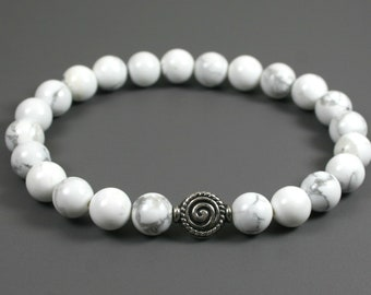 Howlite stacking stretch bracelet with an antiqued silver plated spiral focal bead