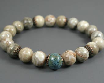 Fossil coral stacking stretch bracelet with a turquoise ceramic accent bead and antiqued copper-plated brass bead caps