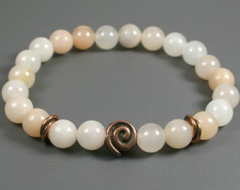 Pink aventurine stacking stretch bracelet with a Greek bronze plated spiral focal bead and antique copper plated twisted spacers