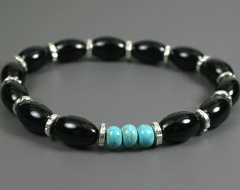 Black onyx, turquoise magnesite, and silver plated roundel stacking stretch bracelet