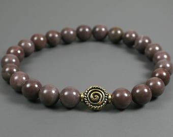 Purple aventurine stacking stretch bracelet with an antique gold plated spiral accent bead