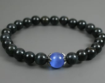 Blue tiger eye stacking stretch bracelet with blue glass cats eye accent