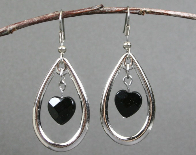 Rhodium plated open teardrop earrings with faceted black onyx hearts on stainless steel ear wires