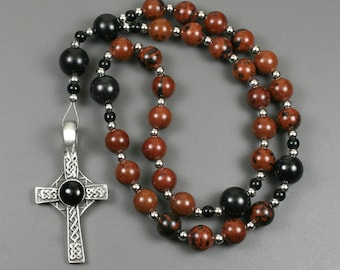 Anglican rosary in mahogany obsidian with a antiqued pewter Celtic cross with a black resin inset