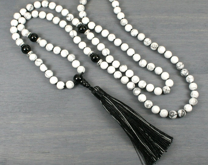 White howlite and black onyx hand knotted mala in the Zen style with tassel