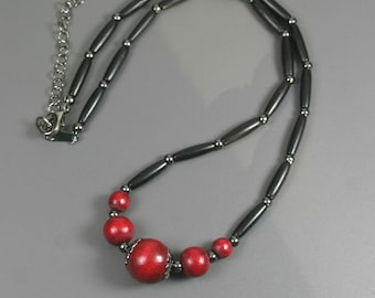 Cranberry red wood and black bone hairpipe necklace with gunmetal accents
