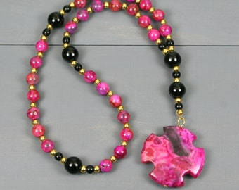 Small Anglican rosary in pink crazy lace agate with obsidian and a pink crazy lace agate Greek cross