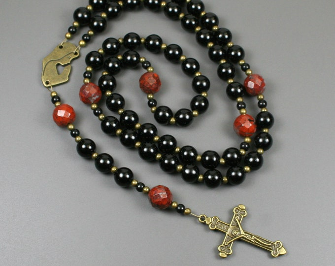 Obsidian, poppy jasper and antiqued brass rosary in the Roman Catholic style