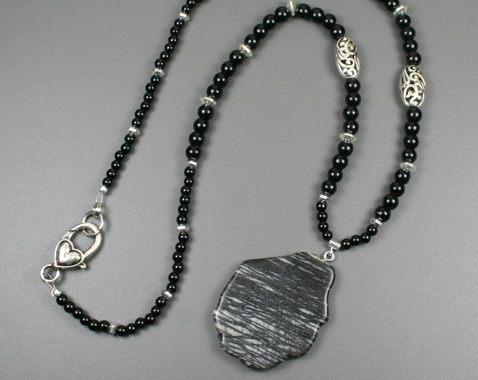 Picasso jasper pendant on a strand of obsidian with silver plated accents