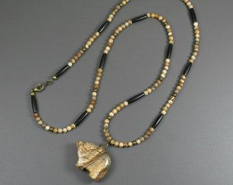 Picture jasper bear pendant on strand of picture jasper, black bone, and antiqued brass