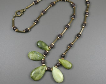 New olive jade teardrop fan necklace on strand of wood, antiqued bone, and antiqued brass