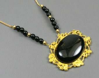 Black onyx pendant in gold plated setting with black onyx and gold plated curb chain necklace