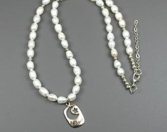 White freshwater pearl necklace with sterling silver Believe charm with crescent moon and star