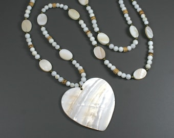 White shell heart pendant on strand of shell, mother of pearl and coconut shell heishi beads