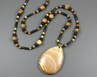 Picture jasper stone teardrop pendant on strand of picture jasper, obsidian and black bone