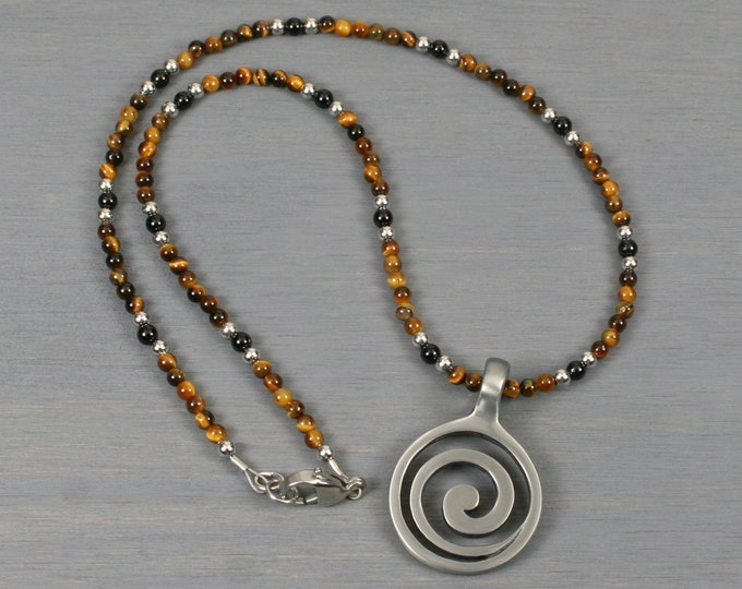 Antiqued pewter spiral pendant in strand of tiger eye and obsidian with stainless steel clasp