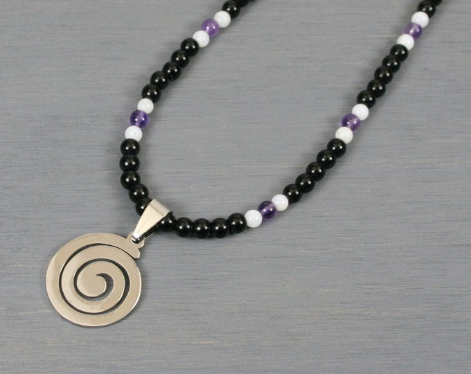 Stainless steel spiral pendant on beaded strand of obsidian, amethyst, and white shell
