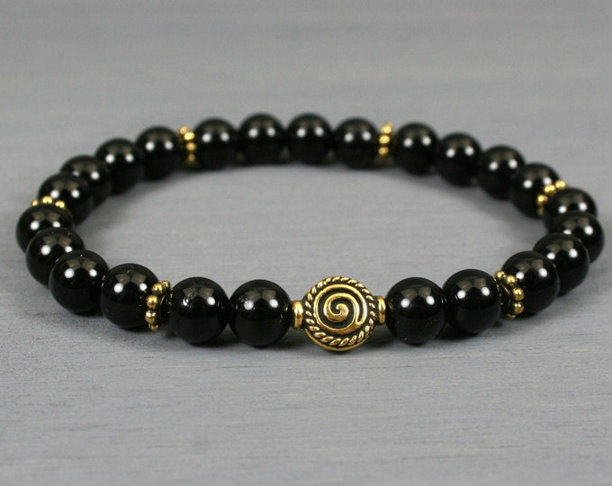 Obsidian stacking stretch bracelet with an antiqued gold plated spiral accent bead and beaded spacers