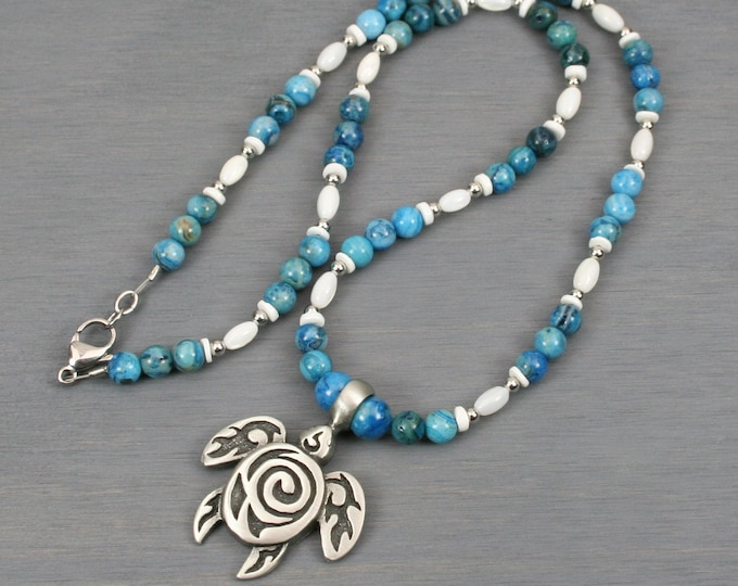 Antiqued pewter sea turtle pendant on beaded strand of blue crazy lace agate and shell beads