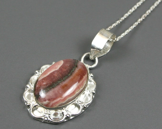 Rhodochrosite pendant in sterling silver plated bezel and bail with sterling silver finished chain