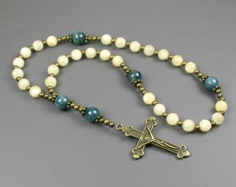 Anglican rosary in yellow calcite, blue apatite, and antiqued brass with an antiqued brass crucifix