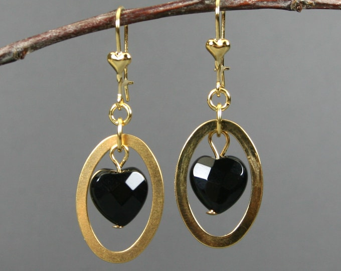 Black onyx heart earrings in gold plated oval dangles on gold plated heart latchback ear wires