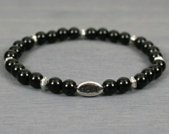 Obsidian stacking stretch bracelet with an antiqued rhodium plated pewter HOPE bead and antiqued silver plated hex spacers