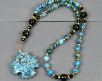 Small Anglican rosary in blue crazy lace agate with obsidian and a blue crazy lace agate Greek cross