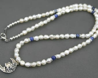Antiqued sterling silver moon pendant on strand of white freshwater pearls and sodalite
