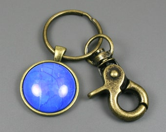 Lapis howlite key chain in antiqued brass setting with swivel lobster claw