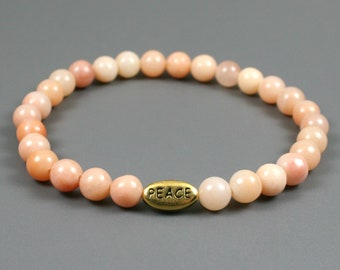 Pink aventurine stacking stretch bracelet with antiqued gold plated pewter PEACE bead, peace bracelet, pink aventurine bracelet